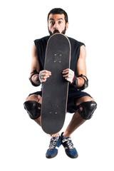 Skater jumping hiding behind his skate