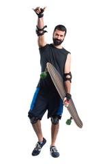 Skater making horn gesture