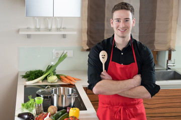 Young smiling Man, ready to cook