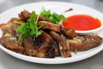 Deep fried sliced duck with chili sauce on white plate asian style
