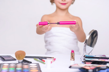 Nice little girl doing make up