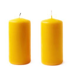 Single yellow wax candle isolated