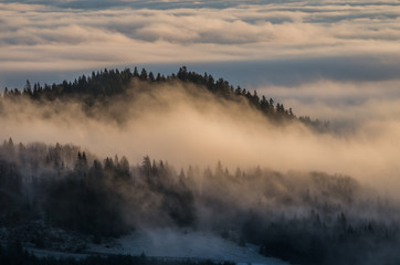 Carpathian mountains in the clouds, seen from Wysoka mountain in Pieniny, Poland