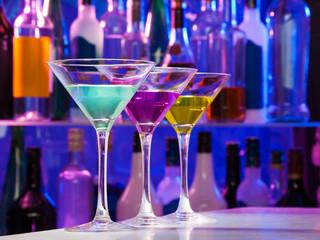 Three color cocktail glasses on the bar table