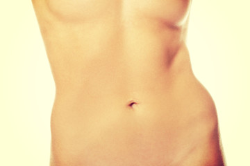 Slim naked woman's belly