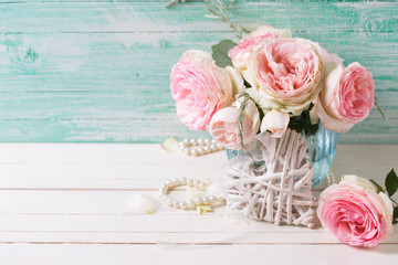 Pink roses flowers  in vase  and decorative heart