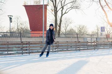 Happy woman skating  at the rink