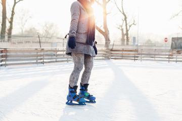 Woman skating at sunset
