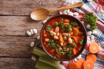 Homemade bean soup, carrots and celery. horizontal top view