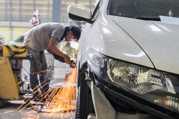 Auto body repair series : Mechanic grinding car body