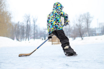 the boy plays hockey