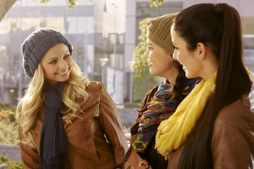 Girls chatting and walking outdoors