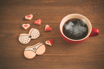 Heart cookies with cup of coffee, toned