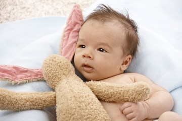 Adorable baby with plush bunny