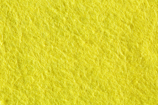 A close up of Yellow felt material texture.