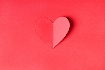 Origami paper heart on a red background is great for Valentine's day wishes, greeting cards or for using in web.