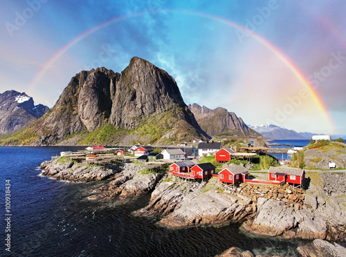 Wall mural Norwegian fishing village huts with rainbow, Reine, Lofoten Isla