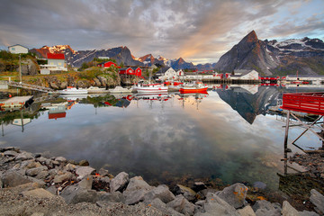 Wall Mural - Norway coast with boat and red huts, Reine