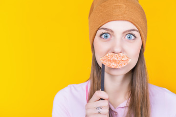 Funny teenage girl holding masquerade lips for party