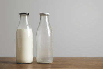 Simple vintage bottles with fresh milk and empty