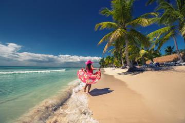 Happy woman on the tropical sandy beach, Saona island, Dominican