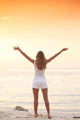 Woman enjoy sunset over sea
