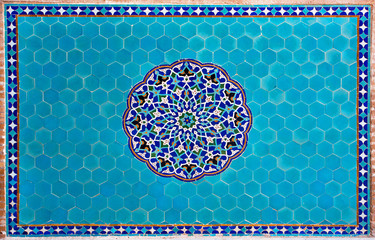 Beautiful blue tiled wall with patterns of Middle East in the historic home