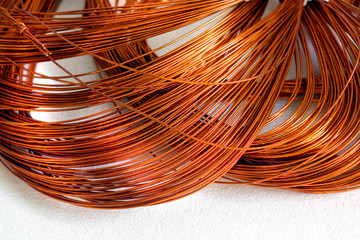 Close-up Skein cooper wire on white background. Copper wire winding, coil, spool section of the electric machine - generator or motor