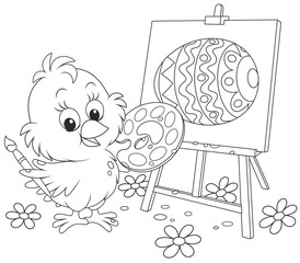 Little chicken drawing a decorated Easter egg