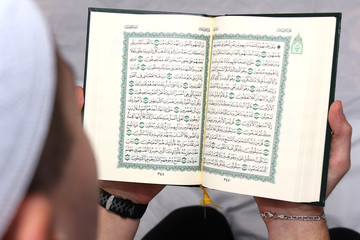 Young Muslim Man Reading The Koran