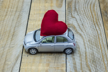 car with a red heart on the roof carrying love