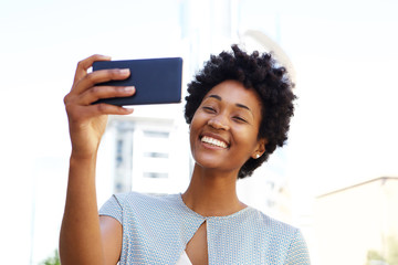 African american woman taking a selfie