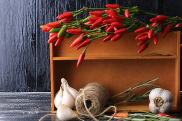 cooking spices in a box on the old wooden background rustic style