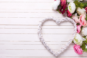 Flowers in pink colors and white decorative heart