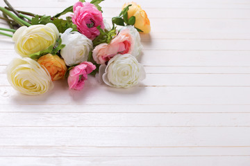 Border from flowers  on white wooden background.