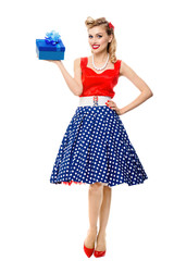 Full body of woman in pin-up style dress with gift box, isolated
