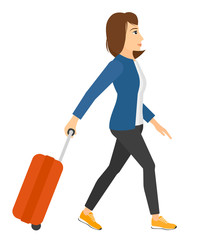 Woman walking with suitcase.