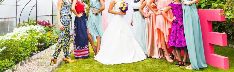 Stylish bridesmaids have fun with bride