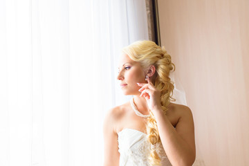 Happy Bride looking in window