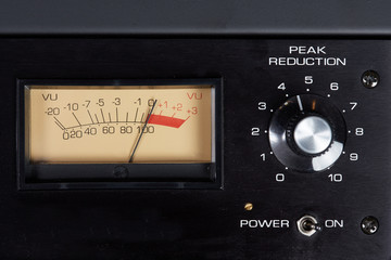 Peak reduction audio hardware with analog VU meter
