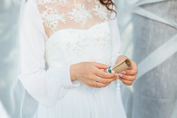 Bride is holding a letter