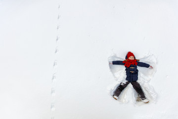Child girl playing in snow