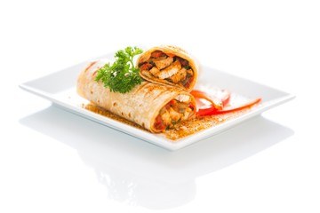 Vegetable and Chicken Wrap Sandwich on a plate stuffed with red peppers and onion