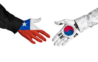 Chile and South Korea leaders shaking hands on a deal agreement