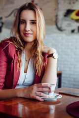 Pretty young woman in a cafe