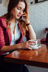 Woman talking in a cafe