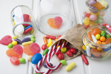 Multicolor candies in glass jars