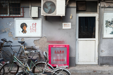 Poster of Chinese hero Lei Feng on the wall of a residential street in Beijing