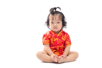 Cute Asian baby girl in traditional Chinese suit Isolated on whi
