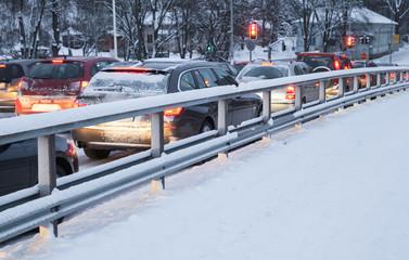 Cars in a traffic jam on winter street